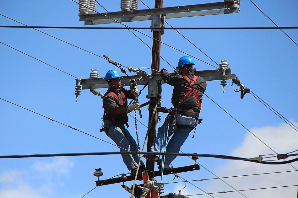 two linemen worker on utility pole
