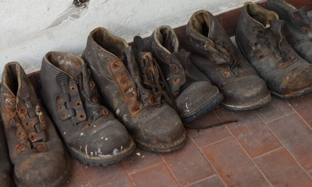 line of work boots with paint spots